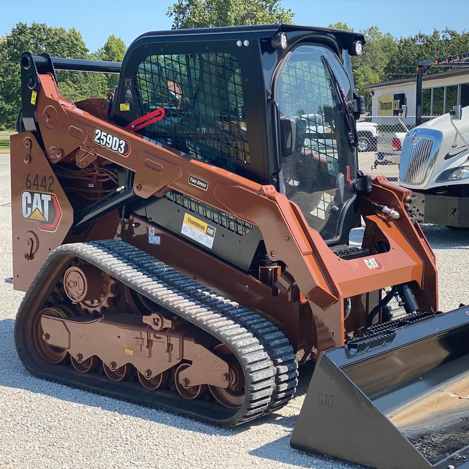 compact track loader painted brown